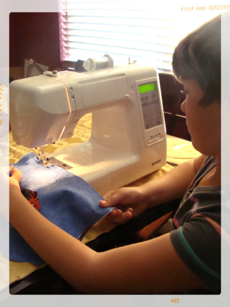 my daughter learning to sew with supervision. kids craft sewing projects for a child learning to sew