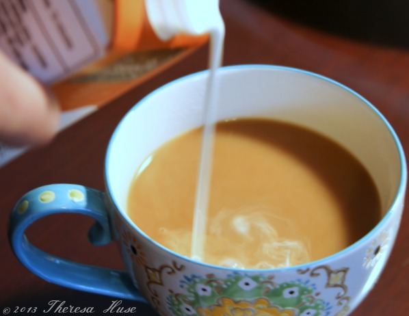 Creamer being poured into coffee in cup, coffee in cup with cream Theresa Huse 2013 -0706