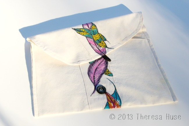 hand drawn feathers on strip made into clutch, bag, Infinity markers, permanent markers on fabric Theresa Huse 2013