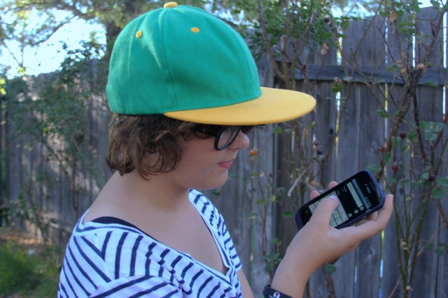 girl with cell phone in hand_#familymobilesaves_#shop