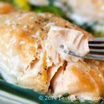 Baked Salmon_Salmon on a fork_flaky delicious easy to make salmon that is baked in the oven. Perfect for meatless Mondays, any night or to impress your guests. Serve with rice, salad, or your favorite vegetables.