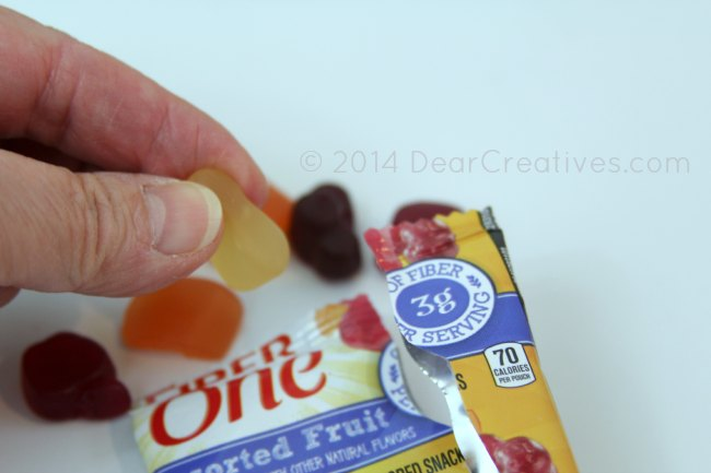 holding a fiber one fruit snack_open fiber one fruit snack_