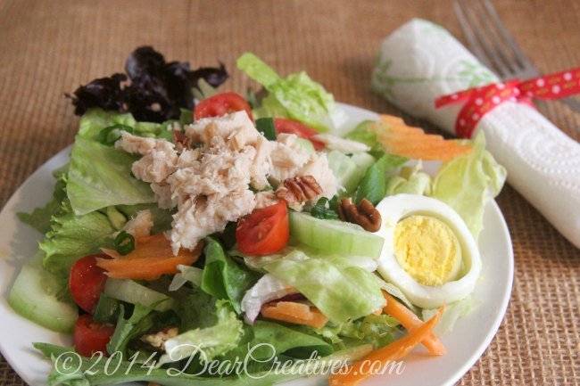 Salad on a plate with napkin and fork_