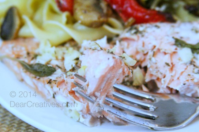 Cooked salmon on a plate_salmon on a fork_