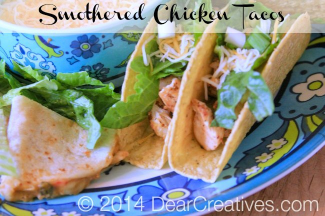 Chicken Tacos Smothered Chicken tacos and quesadillas on a platter with shredded cheese_