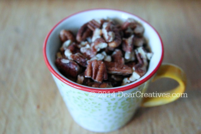 chopped pecans in a measuring cup_
