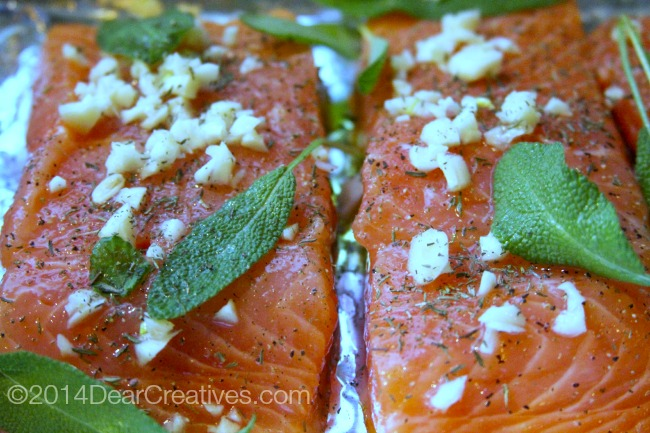 garlic and herbs on raw salmon ready to grill_salmon ready to cook_salmon