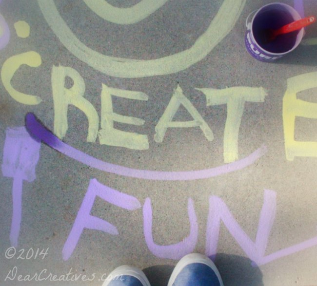 writing with sidewalk paint_