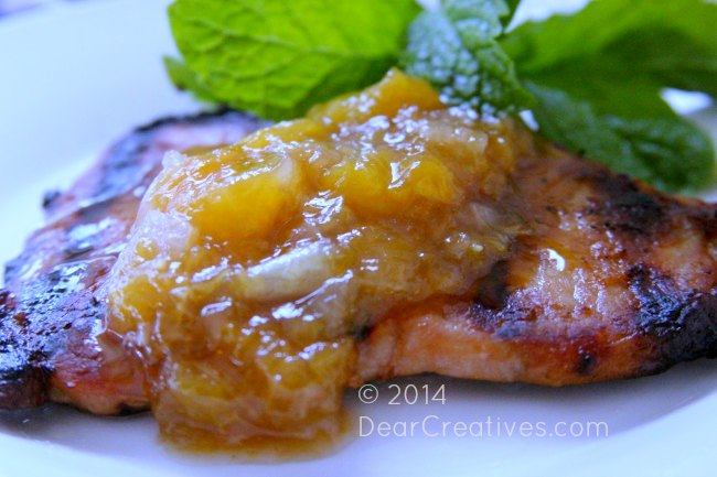 Grilled pork chops with a peach glaze. Grab this grilling recipe for pork chops at DearCreatives.com