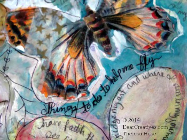 Close up of art journal page_with collage butterfly and handwriting