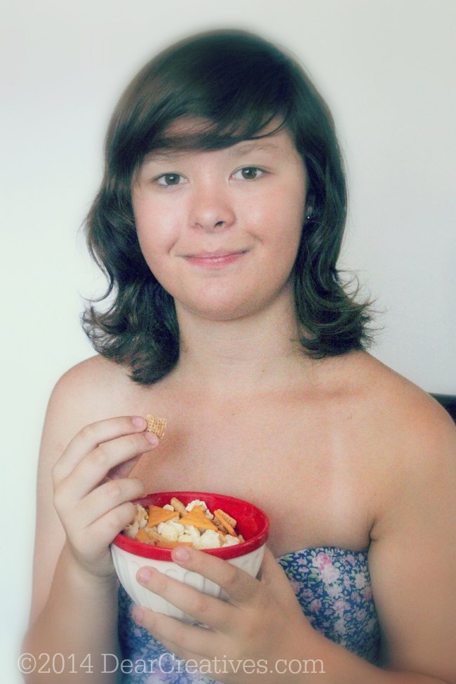 Girl Eating Chex Mix Popped White Cheddar _