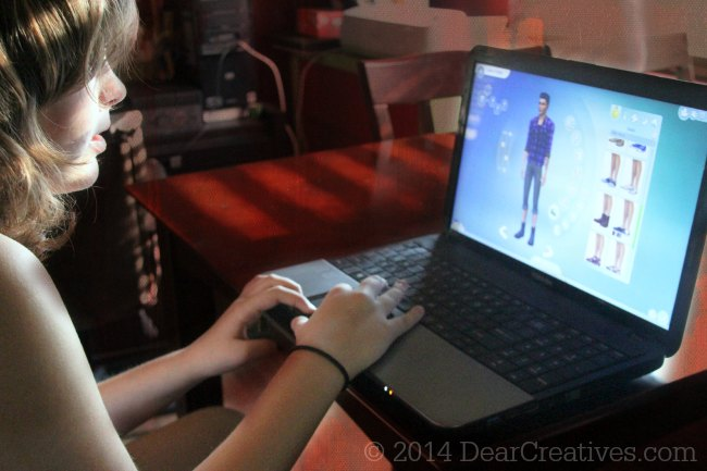 Girl Playing The Sims 4_