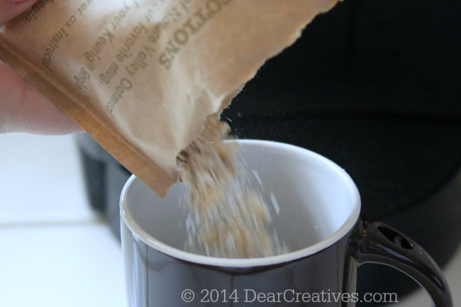 oatmeal being poured into a cup