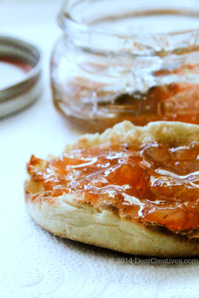 peach jam on a toasted English muffin_