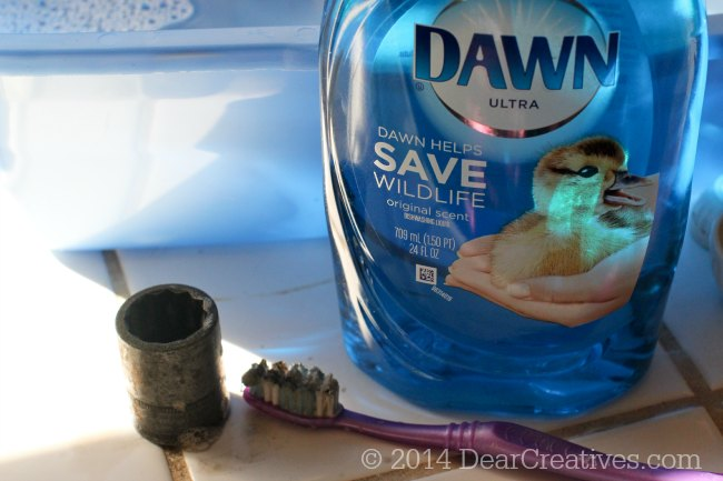 Dirty Socket _Toothbrush for scrubbing and Dawn Dish Washing liquid
