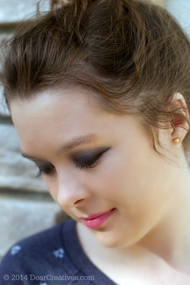 One Direction Limited Edition Holiday Make up on a young lady looking down_© 2014 DearCreatives.com