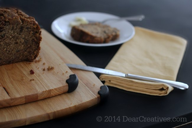 Banana bread on a cutting board and banana bread on a plate in the background_2_ banana bread_ © 2014 Theresa Huse_DearCreatives.com