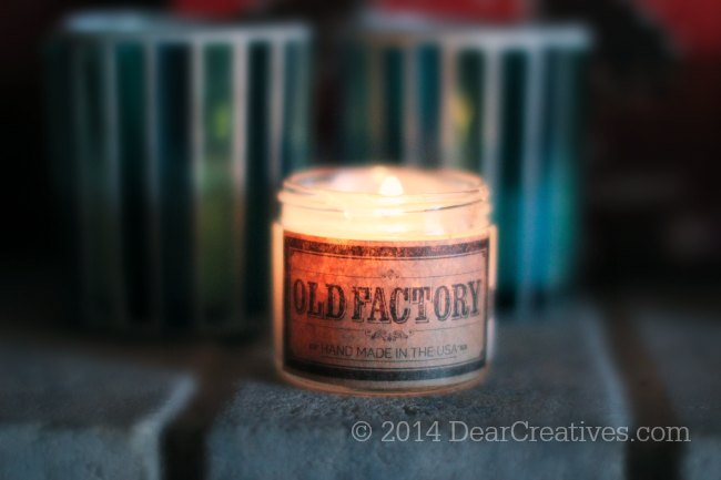 Old Factory Candle_candle burning on a mantle_© 2014 DearCreatives.com