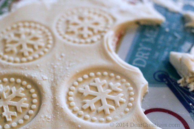 Rolled out cookie dough with snowflakes press into the dough_© 2014 Theresa Huse 2014_ DearCreatives.com