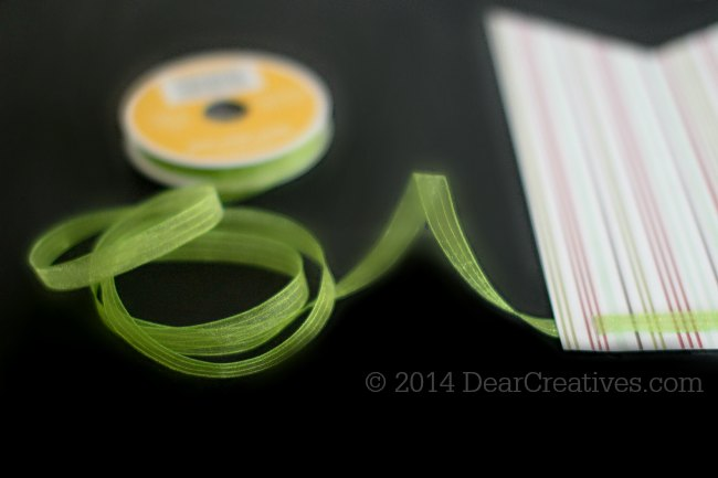Stringing ribbon through the top of the banner_© 2014 DearCreatives.com