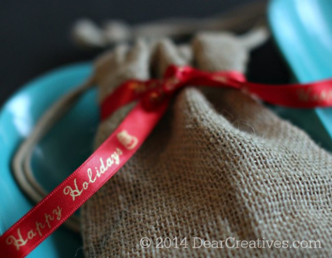 red ribbon printed with gold letters tied around a burlap bag_Epson LabelWorks printed Ribbon_© 2014 DearCreatives.com