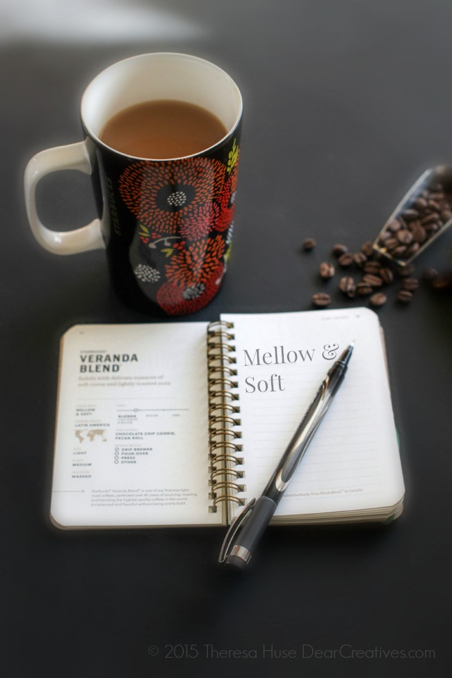 Coffee Cup with coffee- Coffee beans and coffee passport on table_
