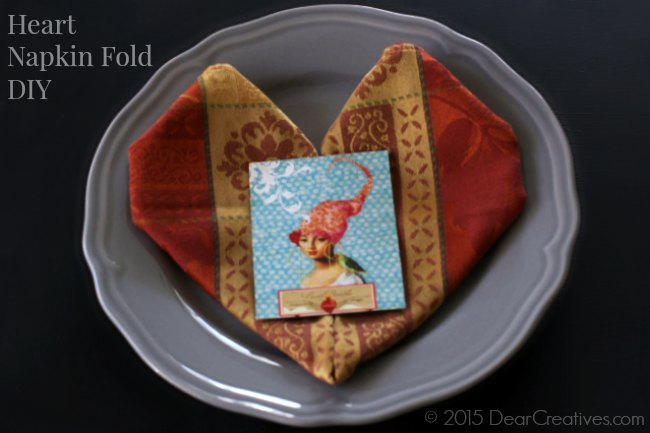 Heart Napkin fold | folded Heart Napkin on a plate