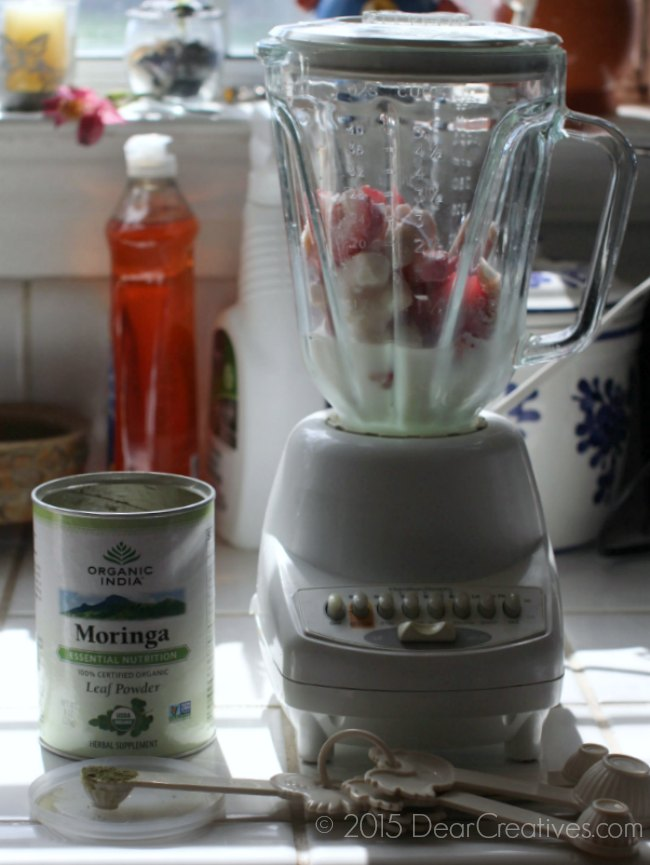 Smoothie in a blender with organic herb Moringa