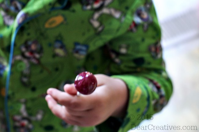 #TheMagicOfSpring |child holding a dum dums lollipop