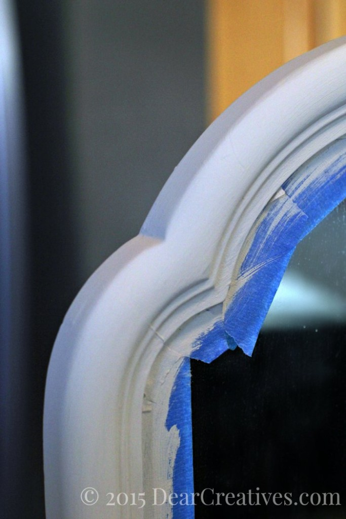 Home Decor Ideas | Taped off vanity mirror being painted