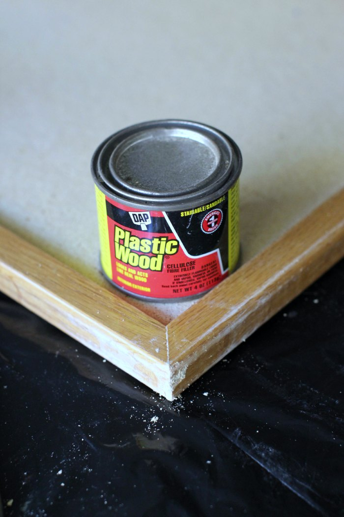 fixing a bulletin board with wood putty
