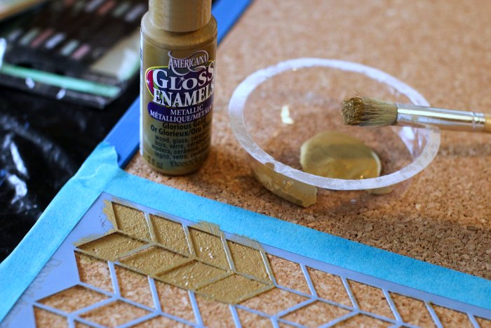 stenciling the cork on the bulletin board - close-up-of-stenciling-with-glorious-gold