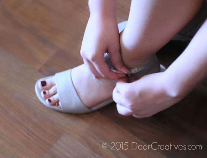 Buckling a leather sandal