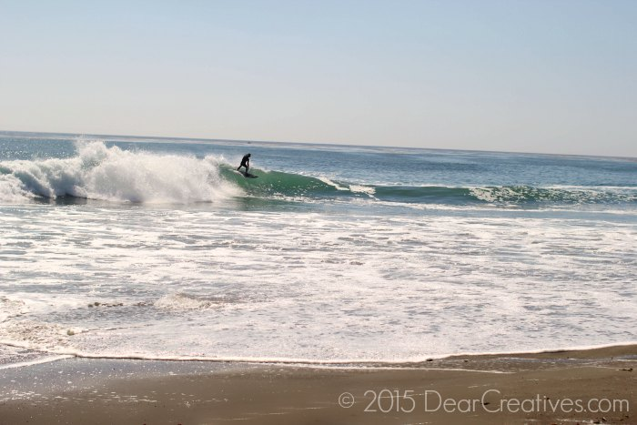 Surfer surfing at a CA beach