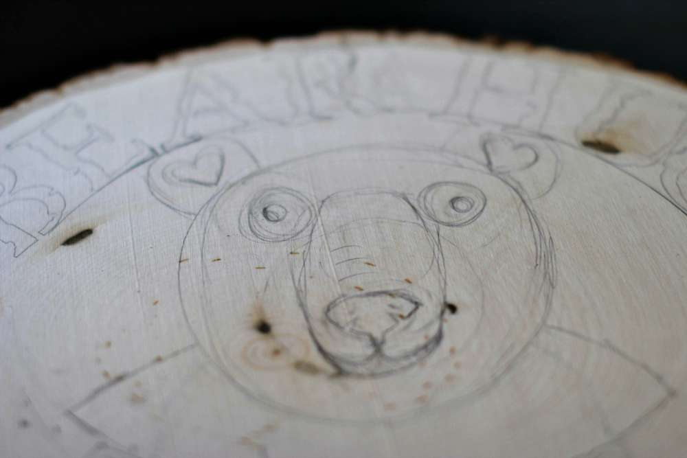 Pencil Draft Bear under Stenciled Lettering- how to create a bear plaque. Easy art and craft project for a wood round. DearCreatives.com