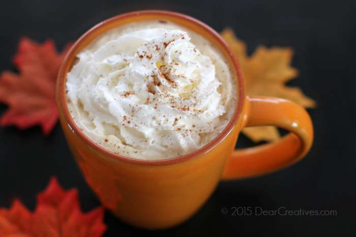 Pumpkin spice latter in a cup with whip cream and cinnamon