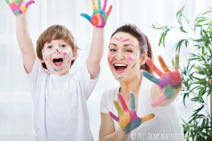 Child painting with mum