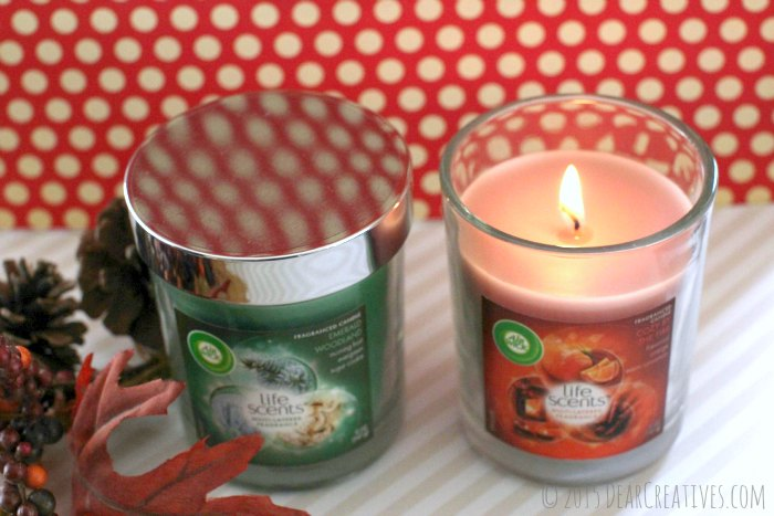 home-Two Air Wick Candles - A burning candle