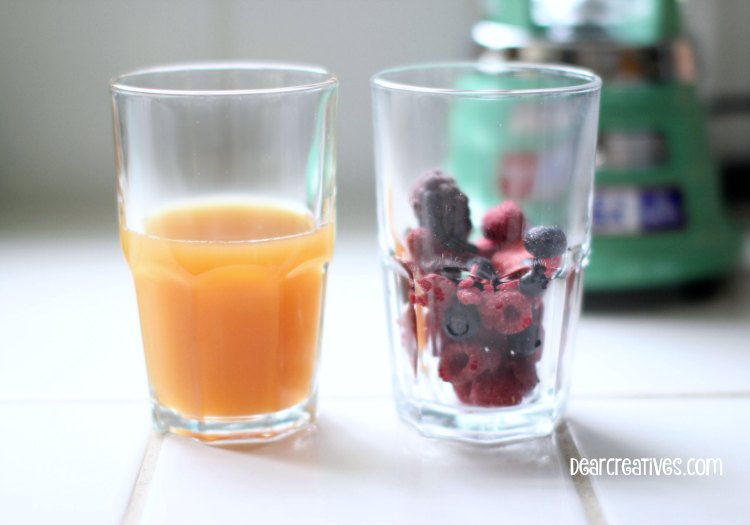 Drink Recipes |Berry Smoothie Recipe | Two Glasses one with apple juice one with frozen berries ready to add to blender