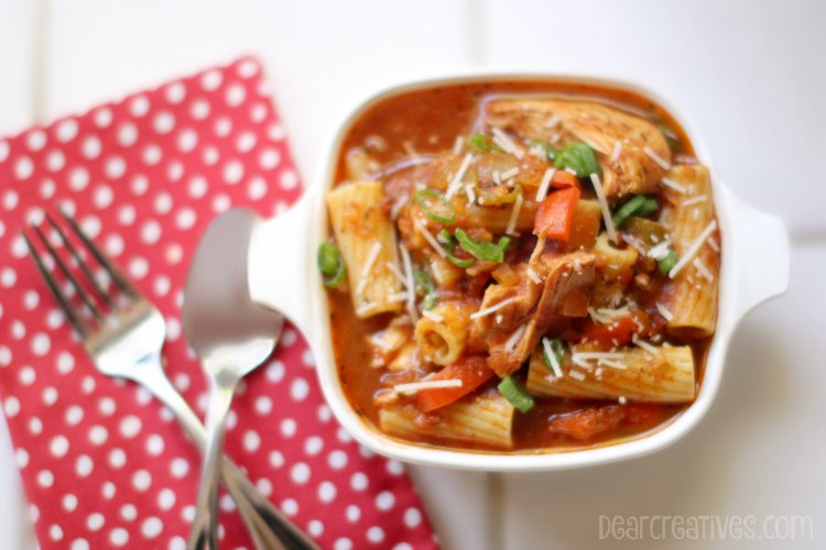 Easy Recipes Slow Cooker | Chicken Cacciatore In a Bowl next to a fork and spoon