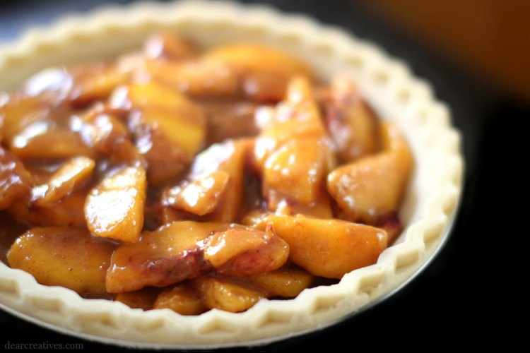 Peach pie ready for topping