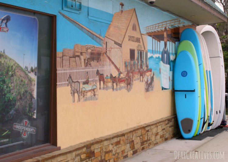Travel California Side of Building at Surf Shop with mural Cayucos California