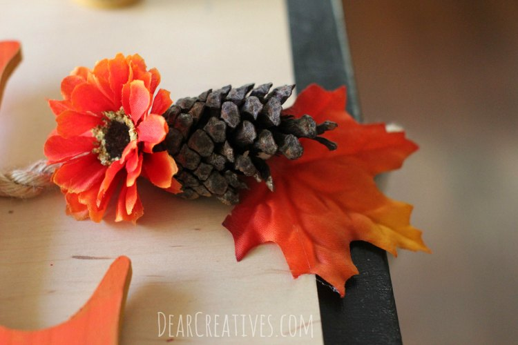 fall-banner-with-wood-letters-and-silk-flowers-on-rope-step-by-step-tutorial-that-anyone-can-make-close-up-of-banner-with-red-orange-flower