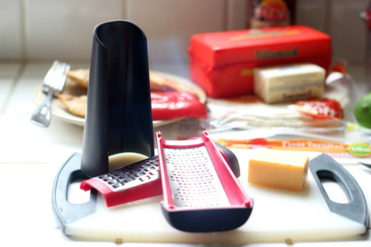 in the kithen- kitchen tools-cooking T-fal cheese grater on a cutting board with cheese © 2017 Theresa Huse dearcreatives.com
