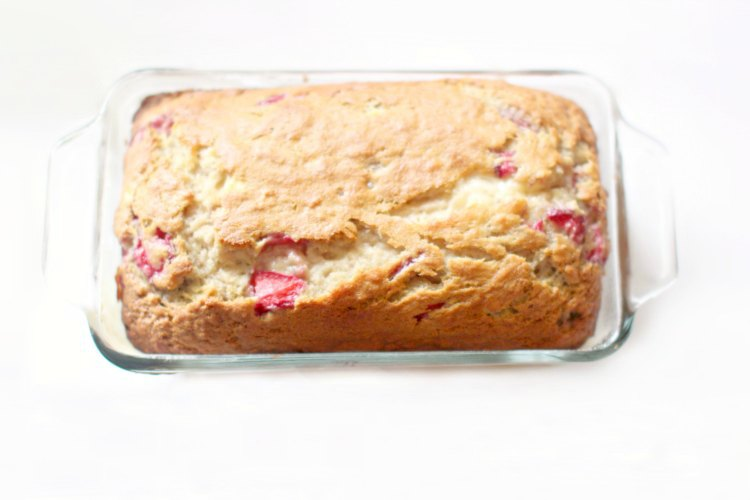 Strawberry Bread Recipe DearCreatives.com Strawberry Banana Bread in a baking dish cooling after being baked. You'll love this easy baking recipe.