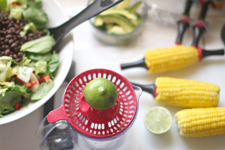 SouthWest Salad Recipe- DearCreatives.com squeezing lime while the corn is cooling off for the Southwest salad.