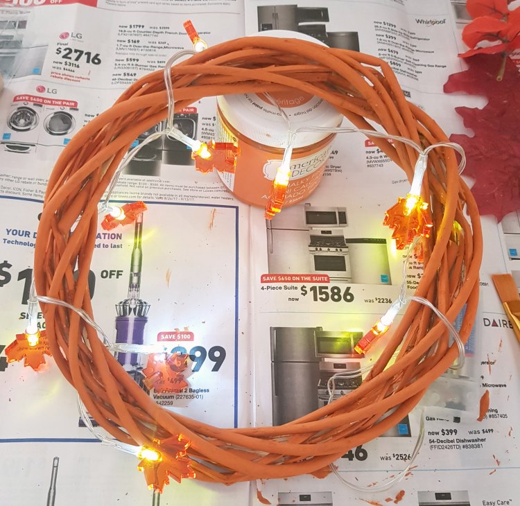 Paint your wreath, let it dry and string lights on to wreath, secure them on. See full grapevine wreath tutorial at DearCreatives.com