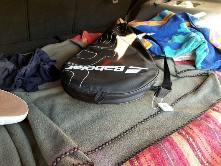tennis racket with tile found on left in trunk of the car