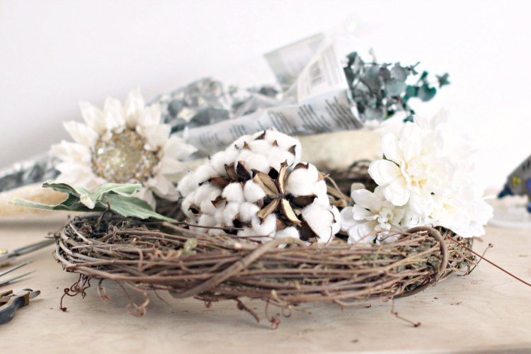 Farmhouse Wreath DIY supplies, grapevine wreath cotton bolls, silk flower, leaves, and tools. © 2017 Theresa Huse