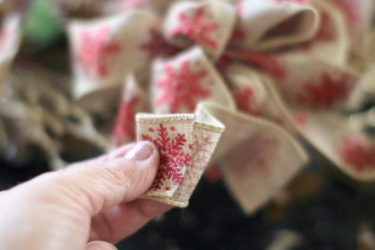 grapevine wreath ideas © 2017 Theresa Huse folding over the back of the wired ribbon to be glued to finish off the handmade bow